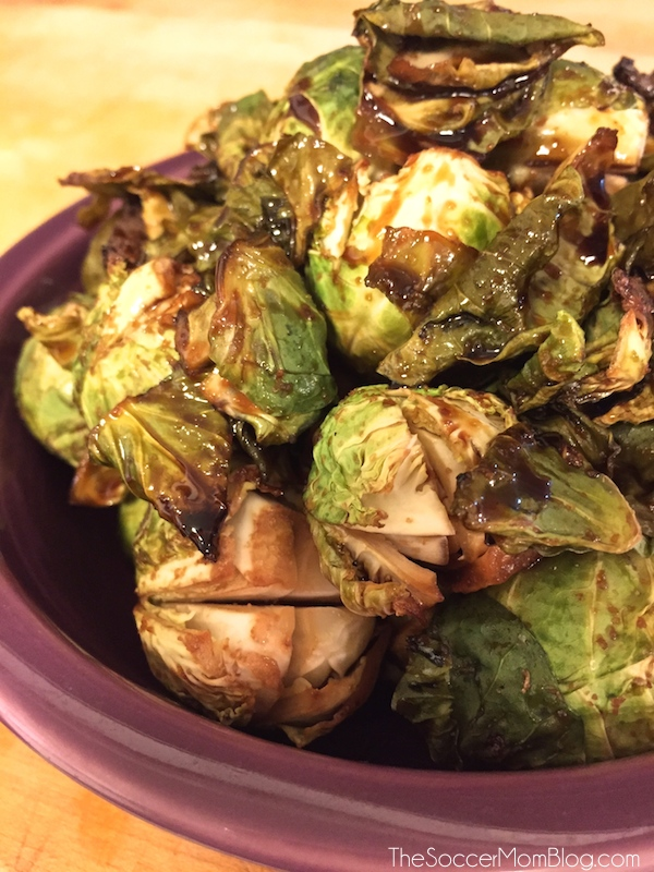 These Asian-inspired Roasted Brussels Sprouts are crispy, sticky-sweet, and savory and only have 4 ingredients! This amazingly simple, yet delicious recipe will make anyone a fan of Brussels Sprouts! They will be your new go-to side dish!