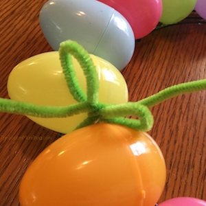 pipe cleaner bow on Easter egg wreath