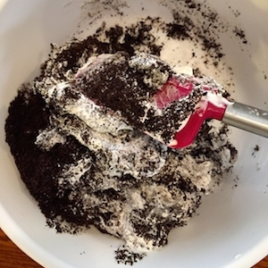 Crushed Oreos and Cool Whip in mixing bowl