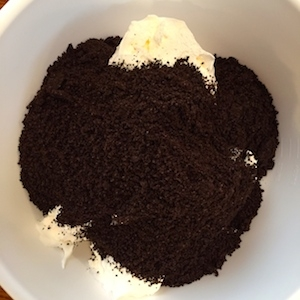 Cool Whip in mixing bowl with crushed Oreo cookies