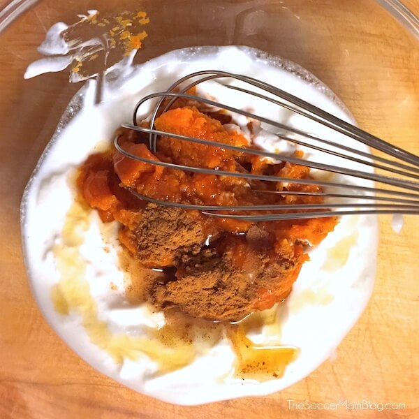 Tastes like pumpkin pie in a glass...and it's good for you! This Greek Yogurt Pumpkin Parfait recipe is high in protein, calcium, and whole grains!