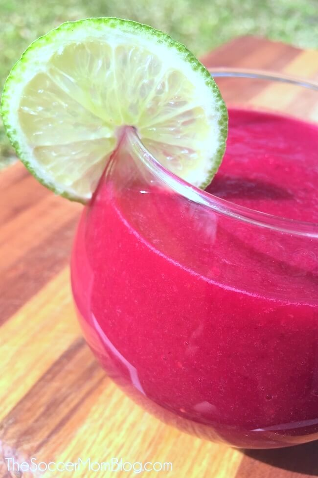 cleansing beet smoothie in a glass with lime