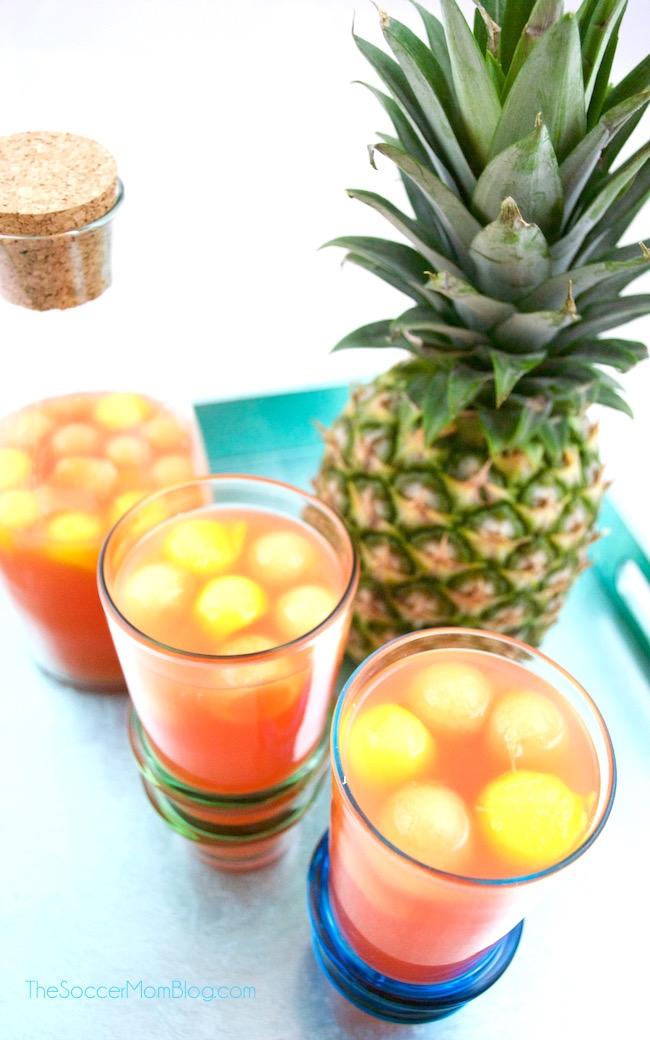 """Just Peachy"" Rum Punch with Fresh Fruit Ice"