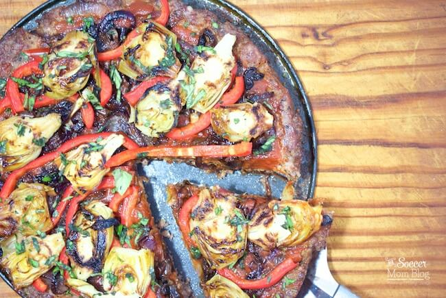 Meat-lovers: THIS is your pizza! This Deep-dish Meatza is PACKED with protein and topped with perfectly caramelized veggies - it's supremely satisfying! Gluten free, dairy free, low-carb - it's a healthy pizza alternative!