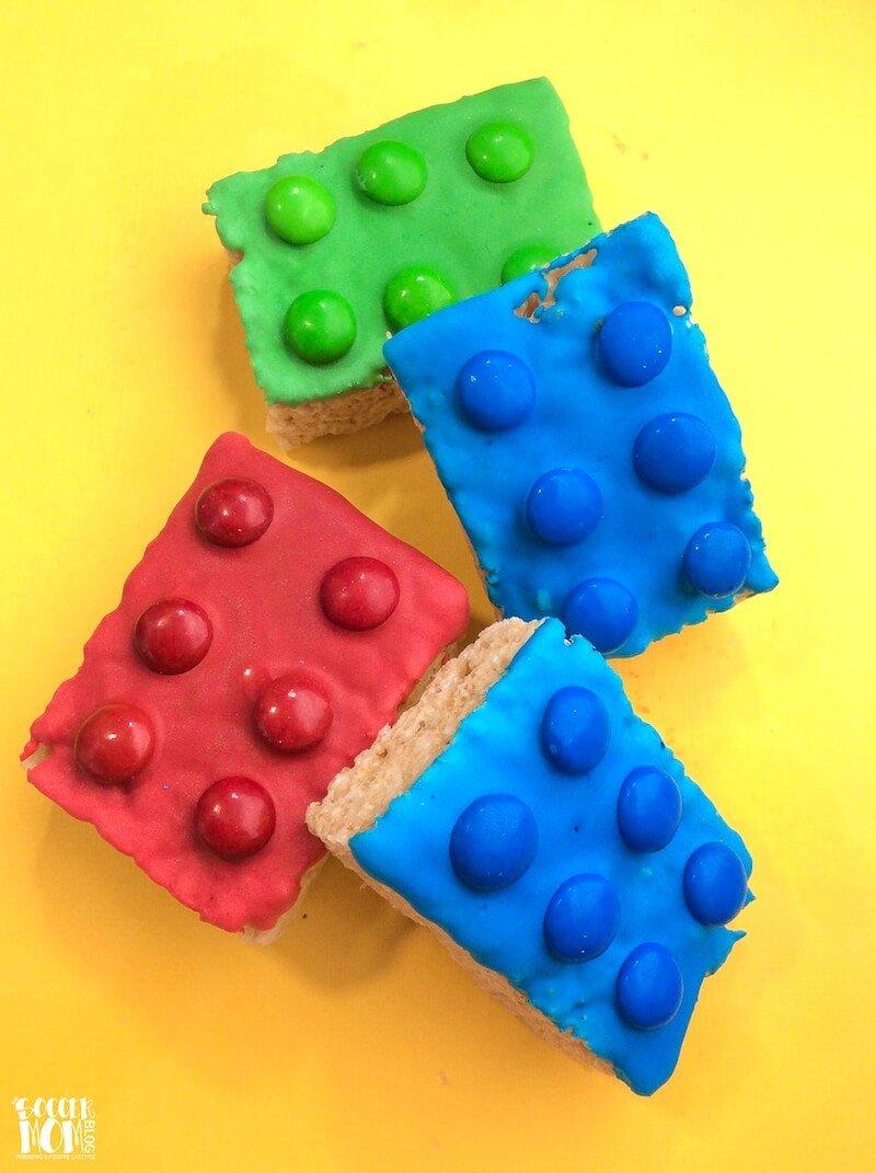 Red, Blue, & Green LEGO Rice Krispie Treats on yellow background