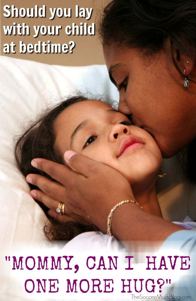 """If you lay with your child before bed will it keep them from learning to sleep on their own? Why you should give in when they ask for """"one more hug"""""""