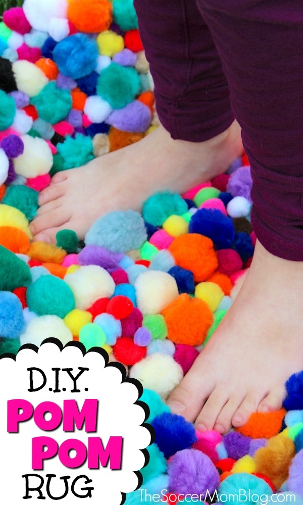 Add a burst of color to any room with this vibrant Pom Pom Rug - an easy DIY craft that's perfect for a kids room, bathroom, reading nook, or anywhere! (FREE photo step-by-step tutorial inside)