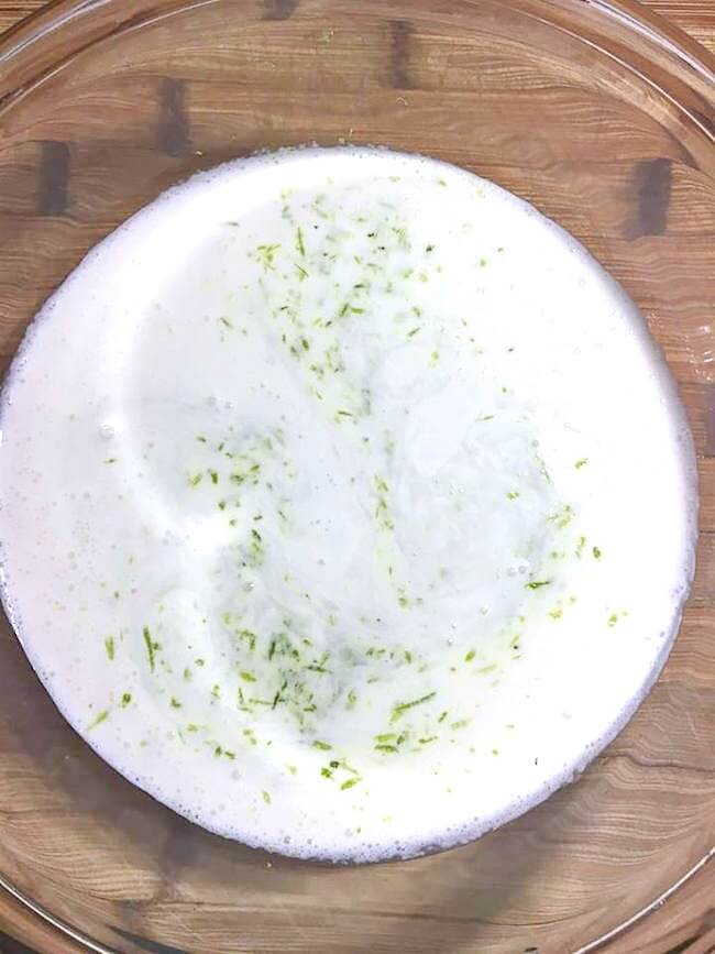 mixing lime zest into milk