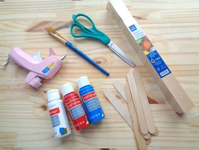 craft and paint supplies on wooden table