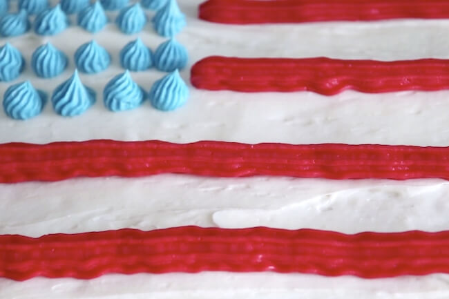 frosting a cake to look like an American flag