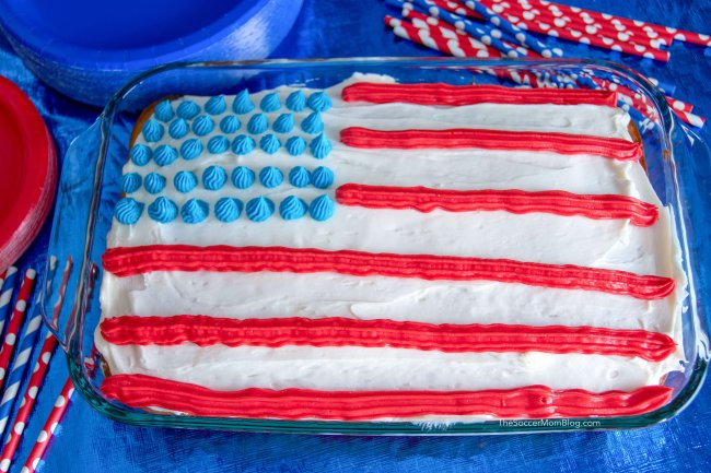 This stunning Red White and Blue Poke Cake is guaranteed to be the star of the party! It's perfect patriotic dessert for Memorial Day and 4th of July!