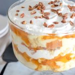 Truly the perfect summer dessert! This easy No Bake Vanilla Pecan Peach Trifle is ready in a jiffy and will be gone just as fast!