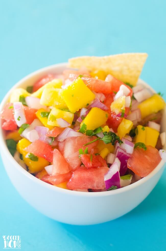 This sweet & tangy Tropical Watermelon Salsa is like a vacation for your taste buds! Easy to make, delicious, and so much healthier than other condiments!