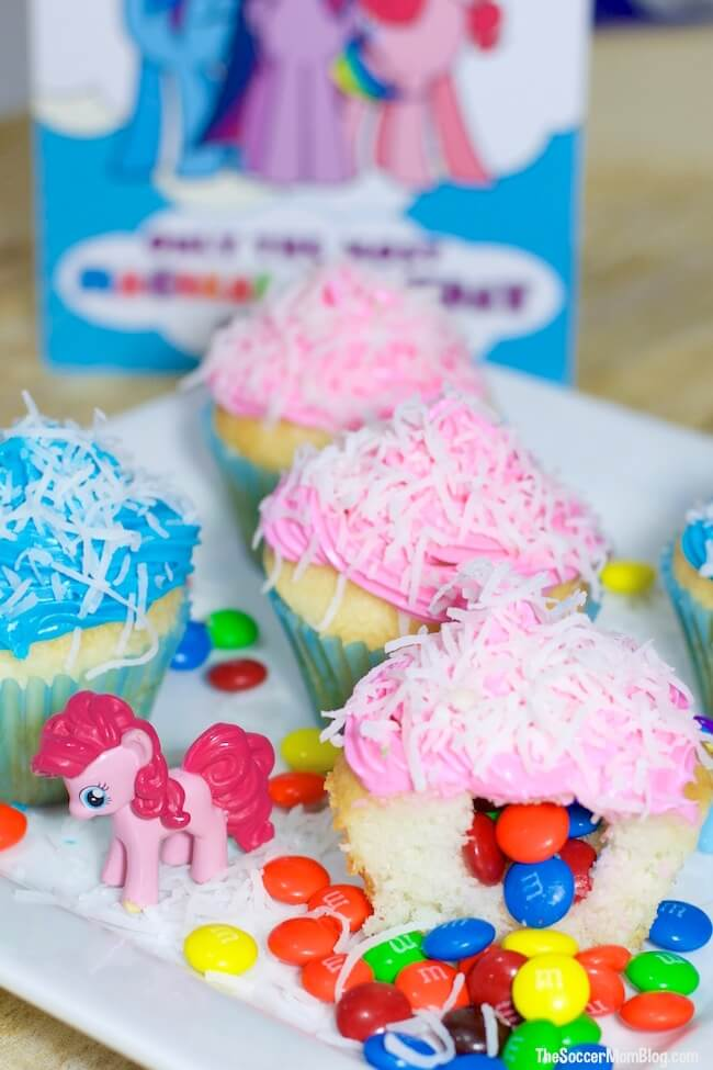 We coated our piñata cupcakes in shredded coconut to resemble the fluttering tissue paper that's used to make the real thing.