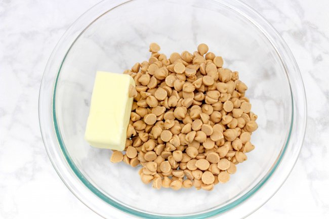 peanut butter chips and stick of butter in mixing bowl