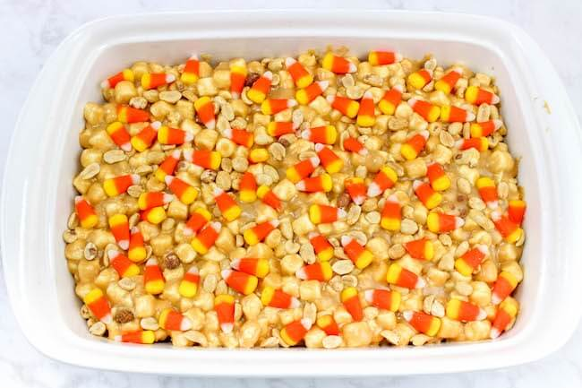 candy corn bars in baking pan, ready to set