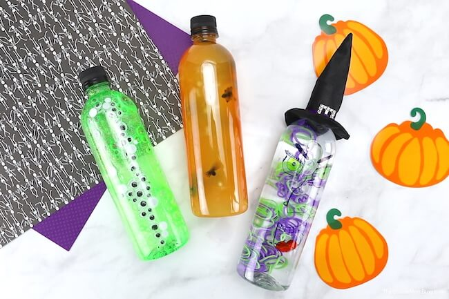 3 Halloween sensory bottles laying on their side