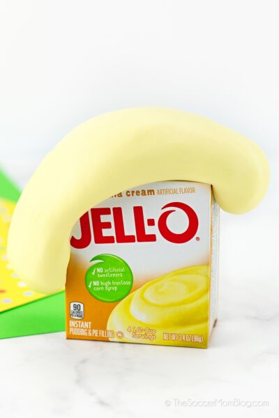 box of Jello pudding with pudding slime oozing on top