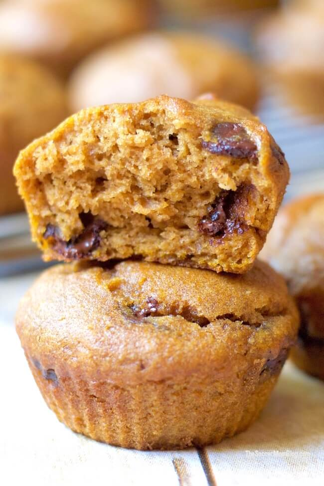 close up of mini pumpkin chocolate chip muffins stacked
