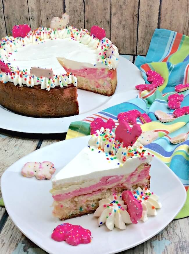 "This recipe puts the ""fun"" in funfetti cheesecake! A funfetti cake-bottom crust pink swirled cheesecake that'll really get the party started!"