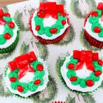 These gorgeous Christmas wreath cupcakes are guaranteed to light up any holiday party! Festive, bright, and way easier to make than you'd expect!