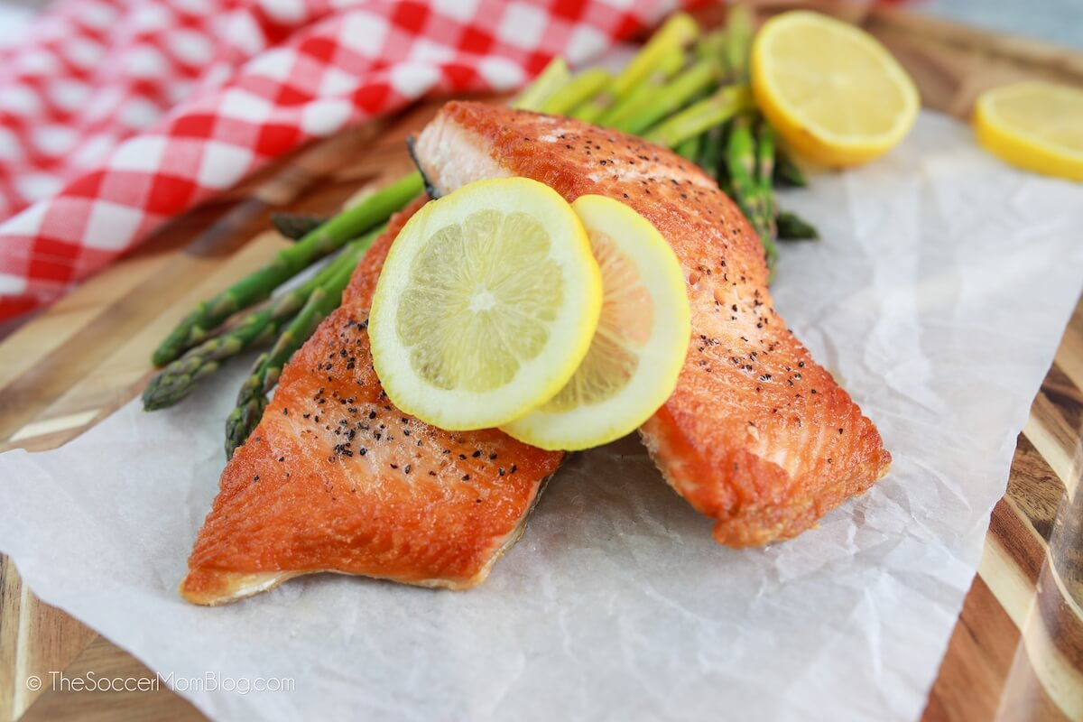 seared salmon filets served with asparagus and lemon