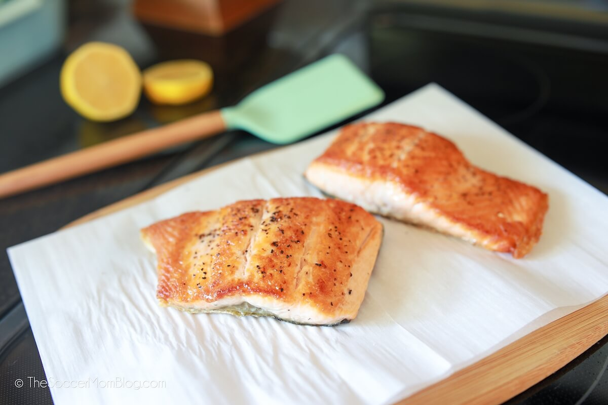 seared salmon filets on parchment paper