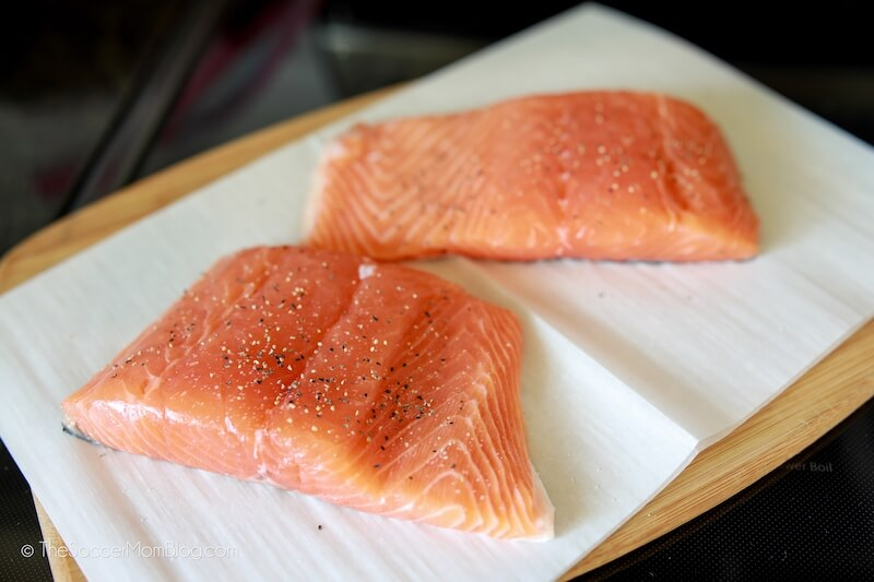 prepping fresh salmon filets to cook