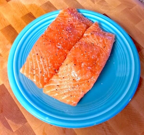 Seasoned salmon filets on plate