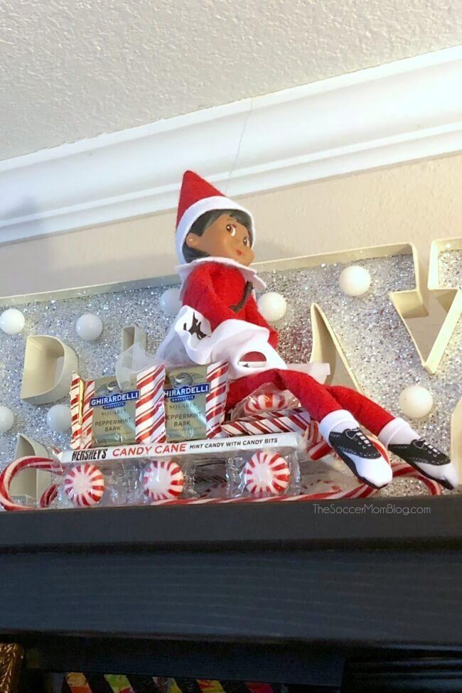 Elf on the Shelf ideas: riding on a candy sleigh