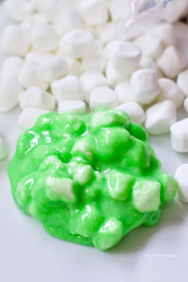 mixing marshmallows into green slime