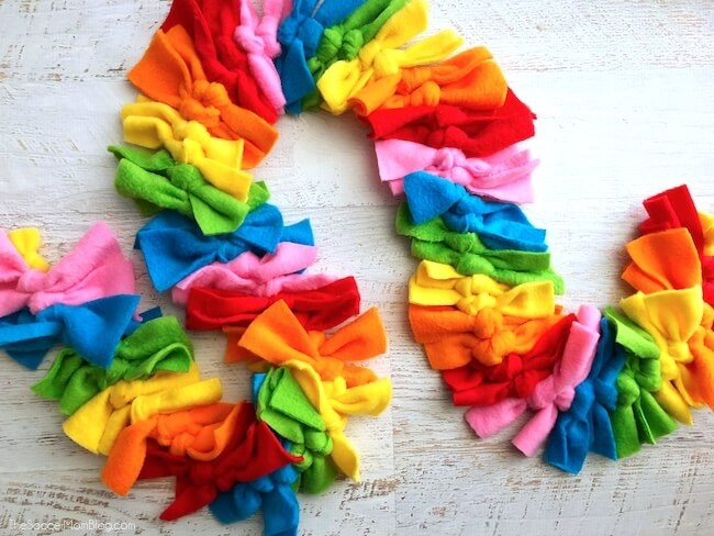 Little fashionistas will love this vibrant Rainbow Dash inspired no sew fleece scarf and you won't believe just how easy it is to make! Simple step-by-step photo tutorial included.