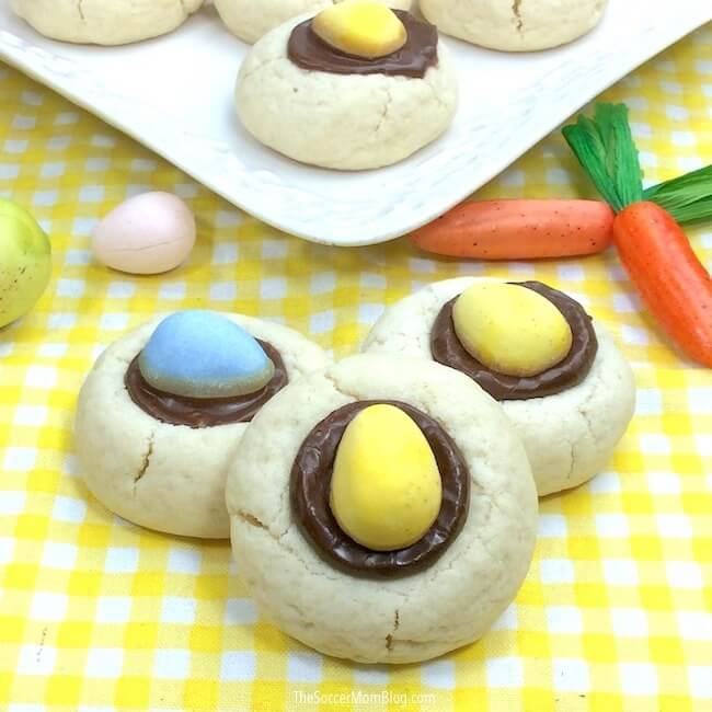 Mini Cadbury Egg Cookies are a festive thumbprint cookie just for Easter! The perfect bite-sized spring treat to make for family celebrations, classroom parties, or just for fun!