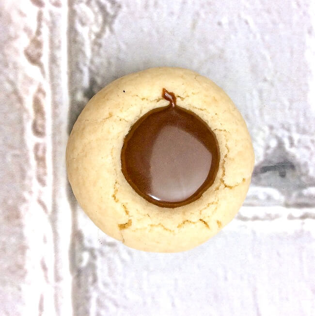 thumbprint cookie filled with chocolate ganache
