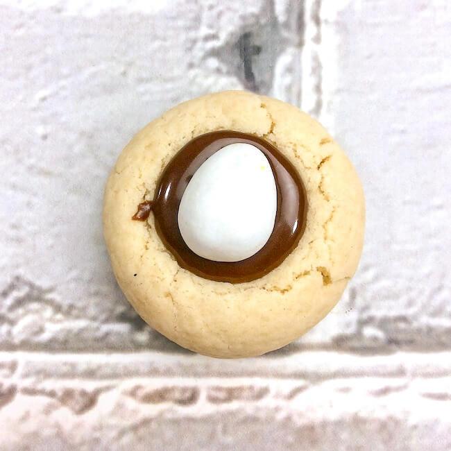 cadbury mini eggs pressed into chocolate cookie filling