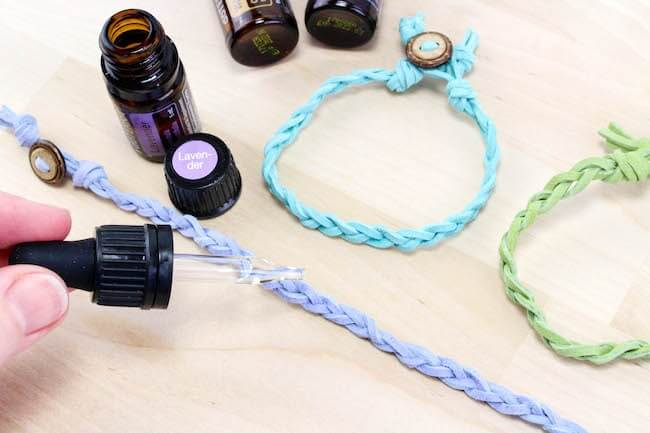 adding essential oils with dropper to aromatherapy bracelet