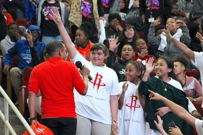 Hill Harper speaking to kids at Houston FutureSmart money education event