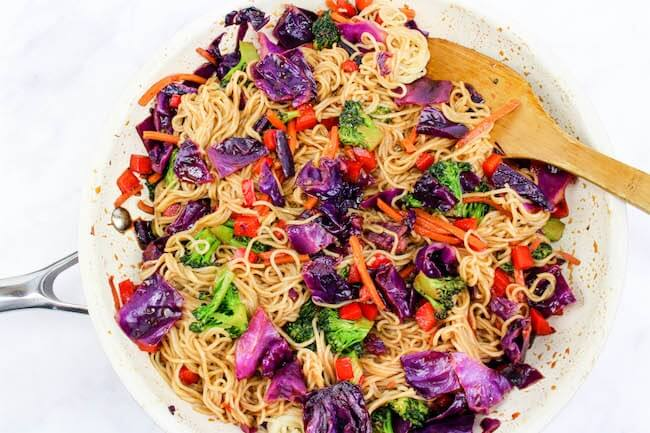 Vegetable lo mein cooking in pan