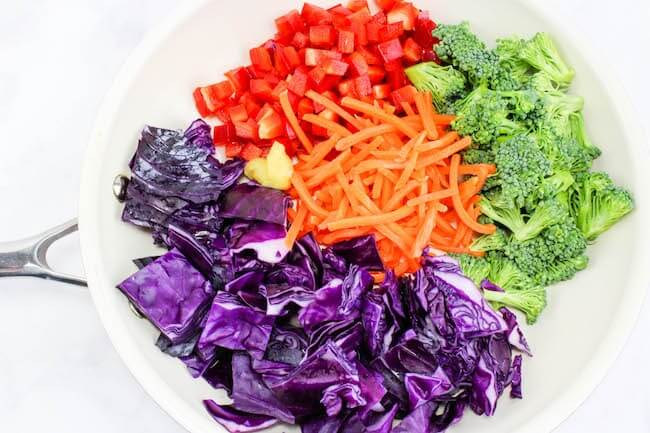 rainbow vegetables in white skillet