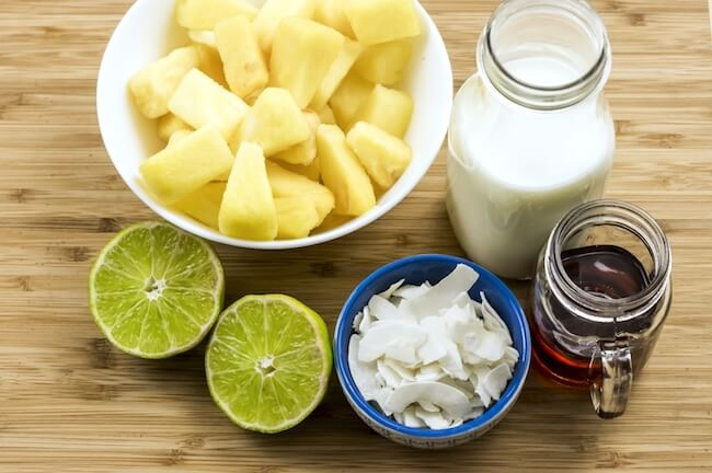 Ingredients to make a paleo version of a pina colada smoothie