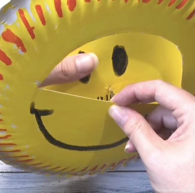Making a paper plate sun craft