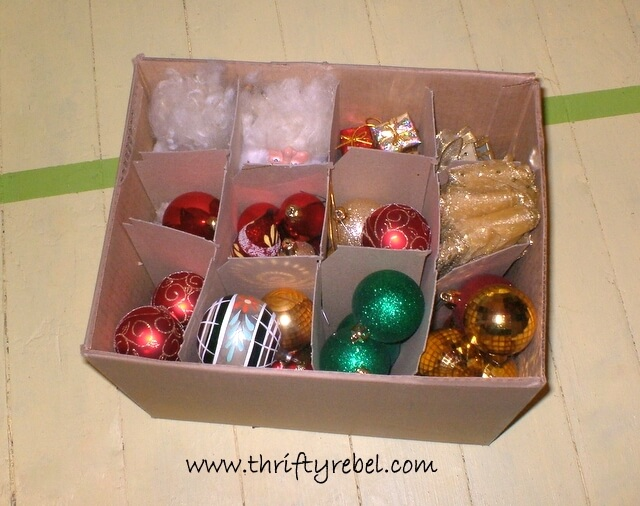 Christmas ornaments stored in an empty wine box