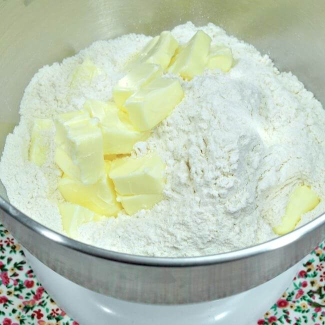 Mixing cubed butter into flour