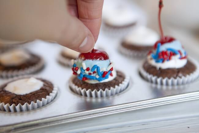 Patriotic brownie cupcakes topped with cherries