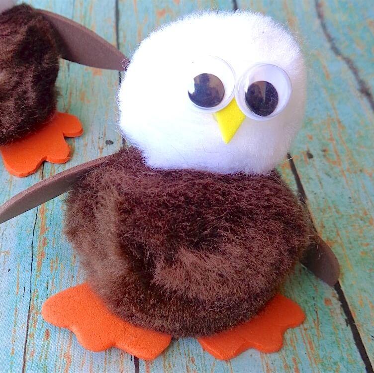 Super cute bald eagle craft made with pom poms