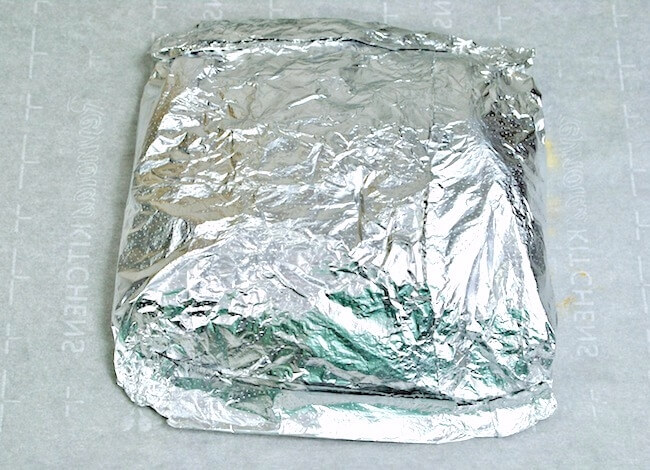 Sealed foil packet on countertop, ready to cook