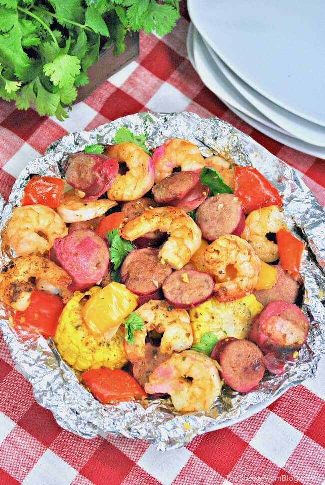 Cajun Shrimp Foil Packets on red checked table cloth