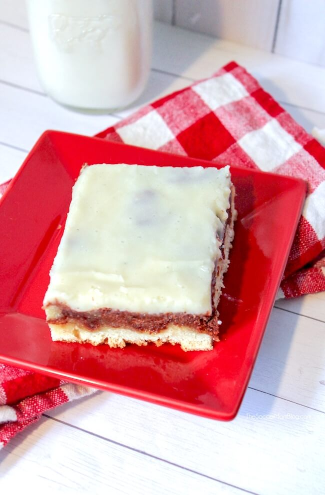 If you love cinnamon rolls then you've GOT to try this decadent Cinnamon Roll Sheet Cake topped with a layer of luscious cream cheese frosting!