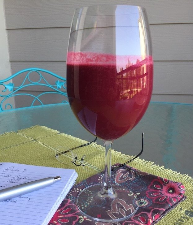 beet smoothie in wine glass