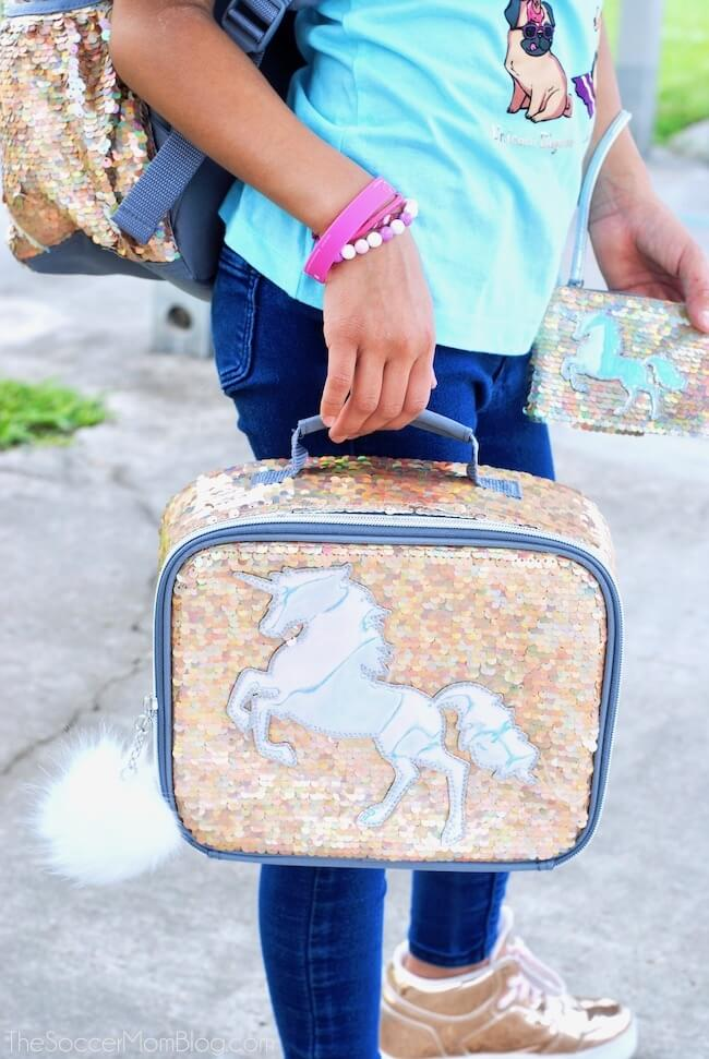 Close up of gold sequin girls lunchbox with unicorn decal